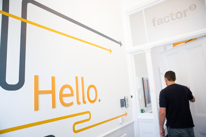Factor 3's entrance hall that has a hello wall sticker which is another example of brand and employee engagement